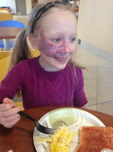 Having breakfast after Addy's latest laser treatment.