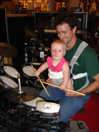 Addy in baby bjorn drumming