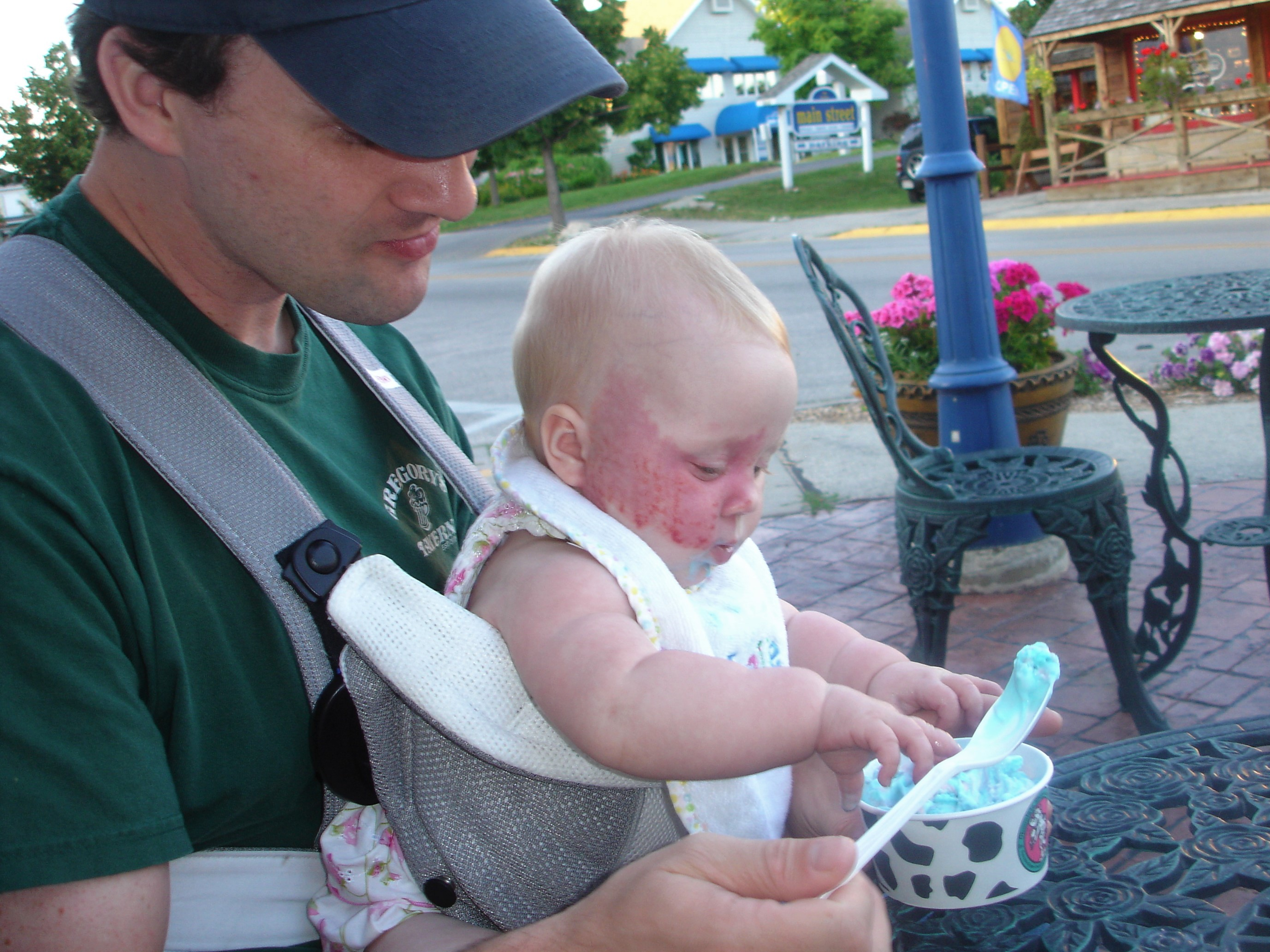 Addy in baby bjorn with ice cream